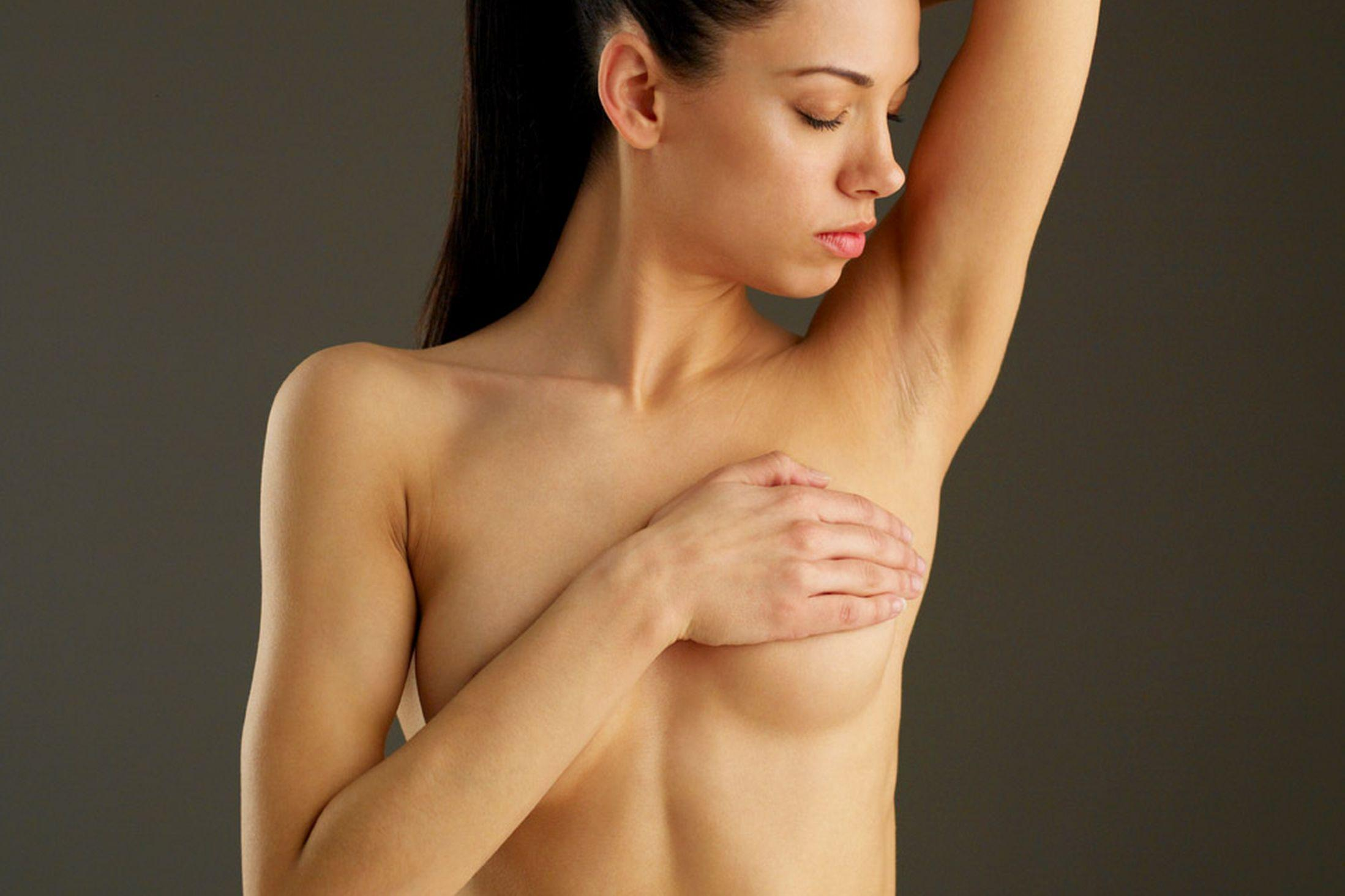 woman-covering-breast-with-hand-1730812